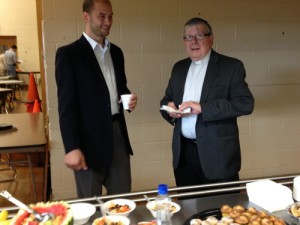Community Ambassadors Co-Director Jeremy Kiner & Father John Nakonachny enjoying breakfast and conversation before a Ministerial Forum